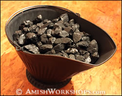 Coal skuttle in an Amish home