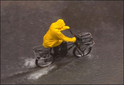 amish-bicyclist-in-rain
