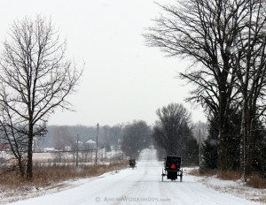 Amish buggies on a snowy road.