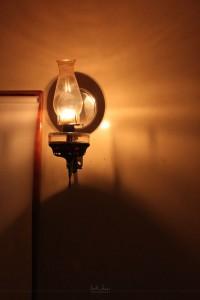 A wall lantern in an Amish bathroom.