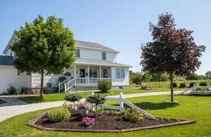 A beautifully landscaped Amish home.