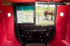 The red velvet interior of an Amish buggy.