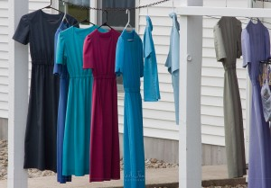 A row of colorful Amish dresses hung out to dry.