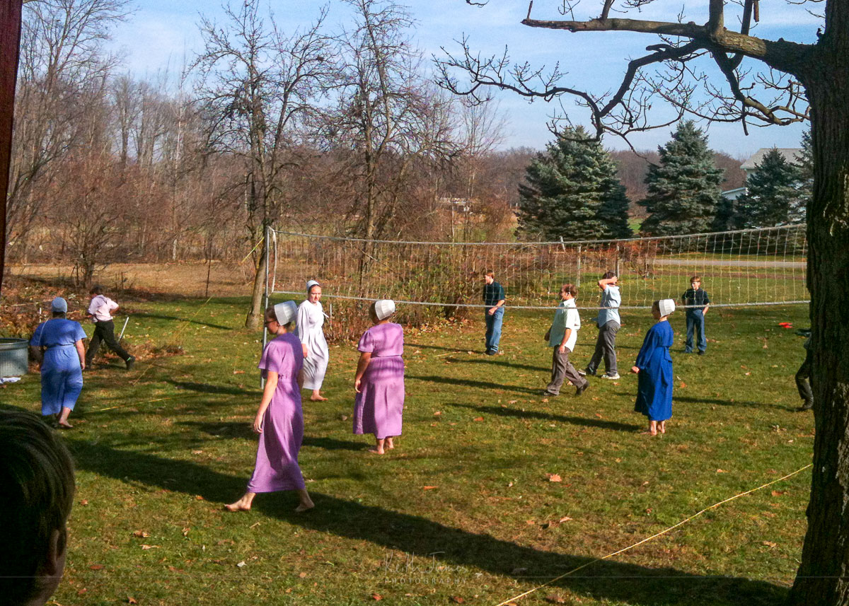 Amish teens play basketball after Thanksgiving supper.